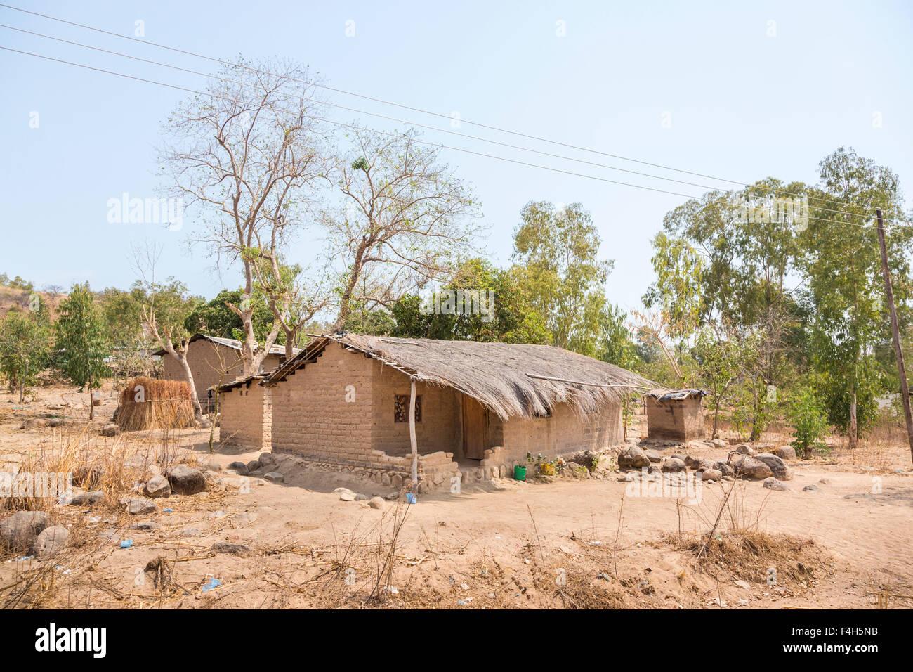 Typical single-storey dried mud brick house with grass thatched roof, Likoma Island, Lake Malawi, Malawi, south - Stock Image