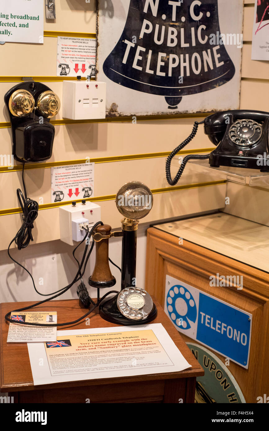 Antique telephones, glass mouthpiece - Stock Image