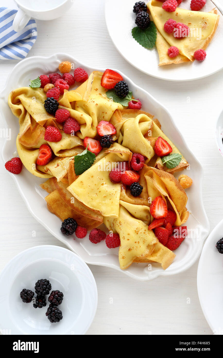 crepes with fresh berries and honey, top view Stock Photo