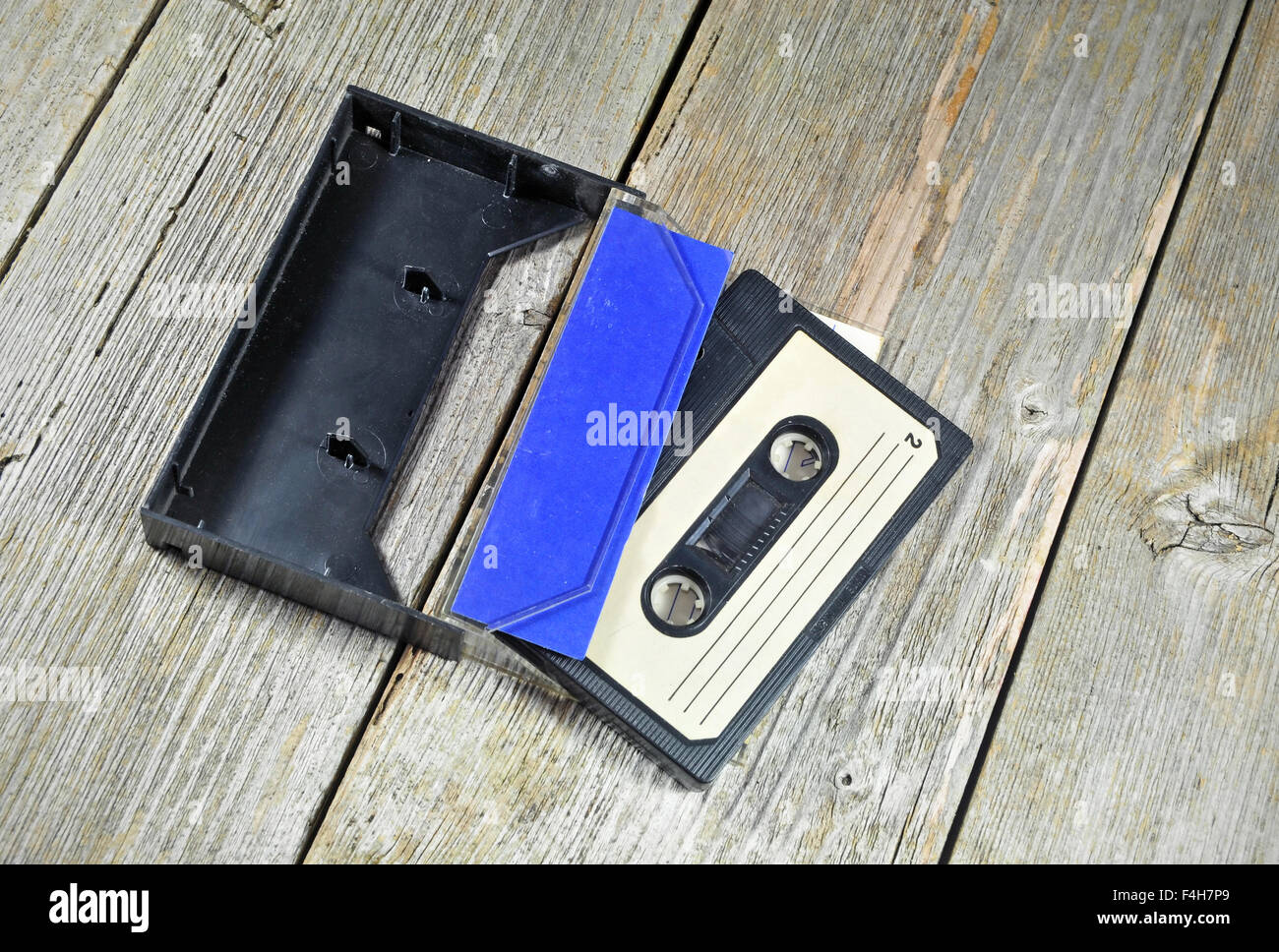 Photo of old music cassette on a wooden table Stock Photo