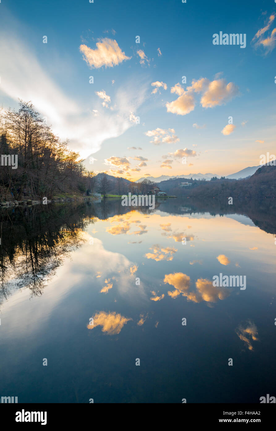 Stunning view of lake Sirio in Piedmont at the sunset, with great sky reflecting itself in the calm water - Stock Image