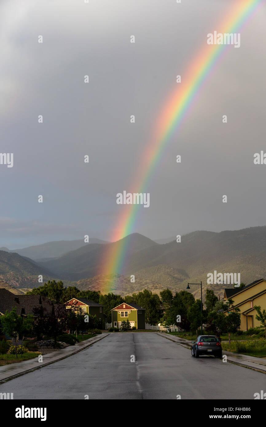 Rainbow over the small mountain town of Salida, Colorado, USA - Stock Image