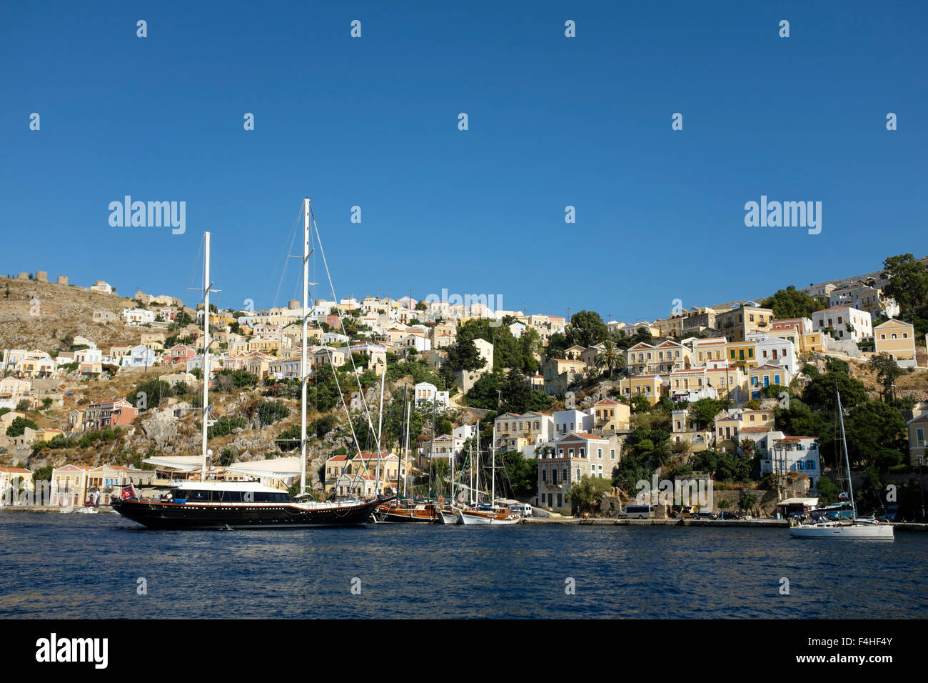 A twin masted sailing ship in Yialos harbour, on the Greek island of Symi. Stock Photo