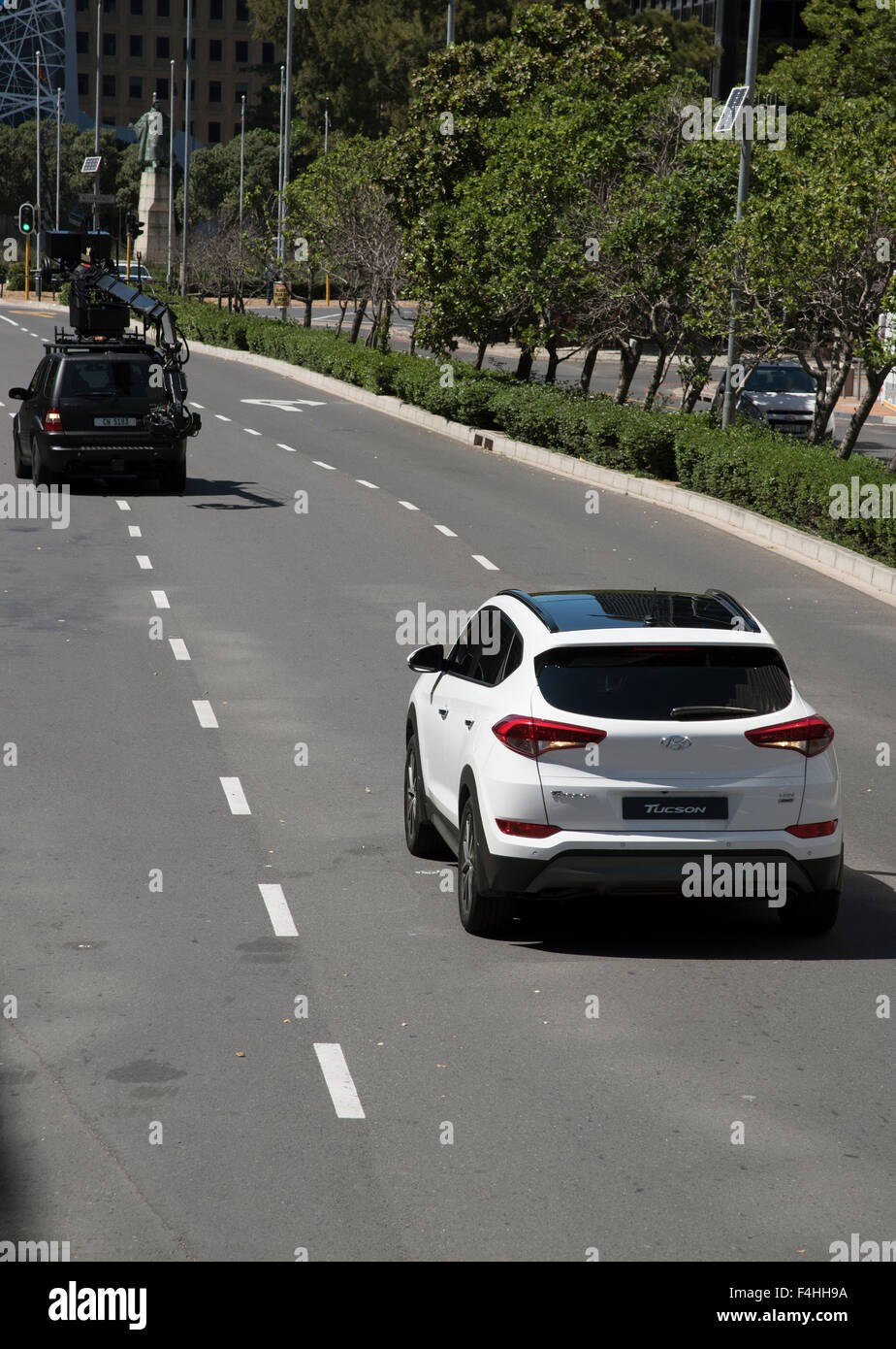 Next generation of Hyundai Tucson CRDi 4 WD  with a glass roof being filmed on a closed street in Cape Town South - Stock Image