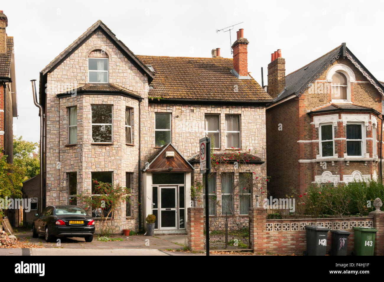 Fake stone cladding on a large South London Victorian house. - Stock Image