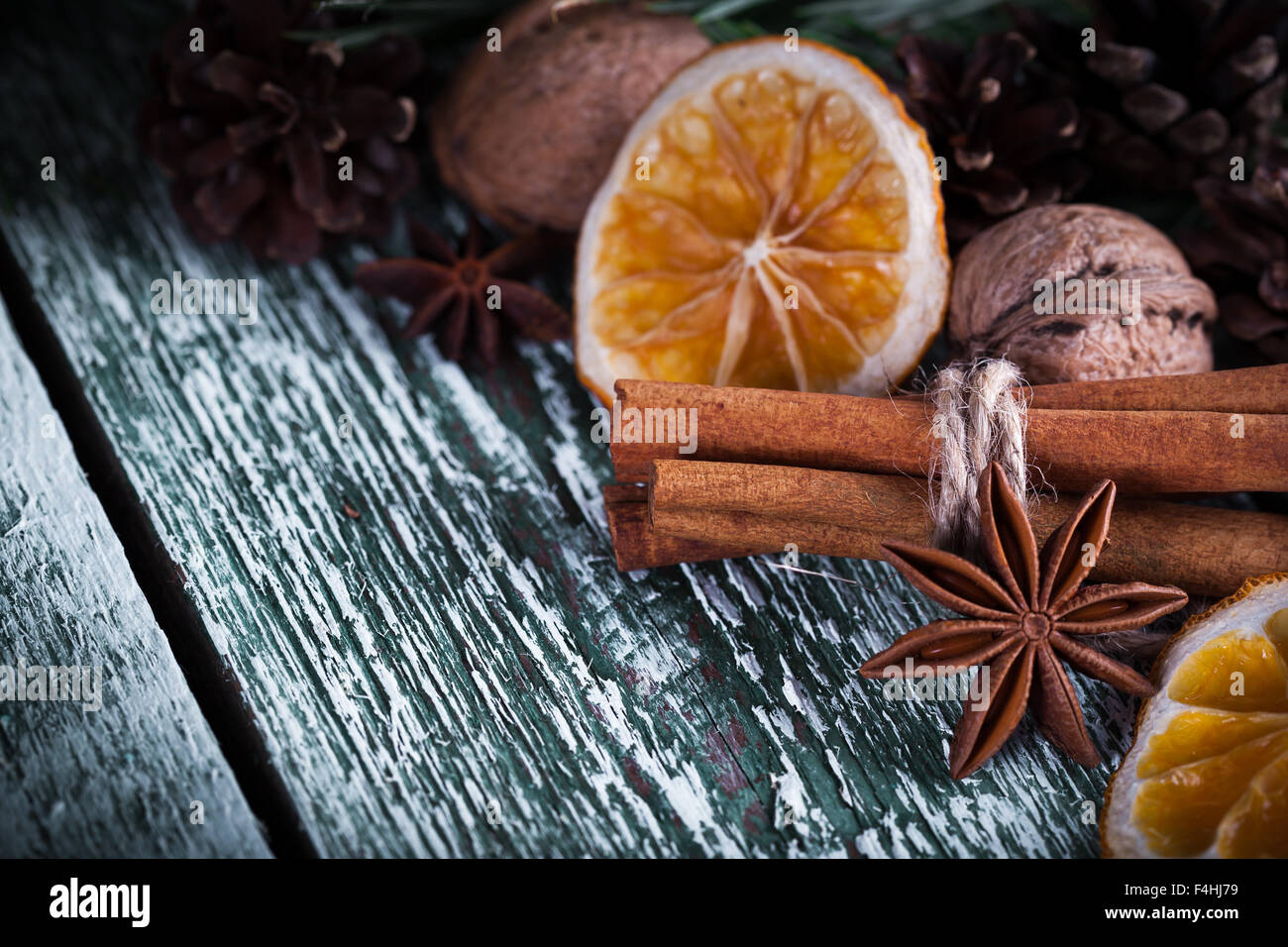 Christmas decoration card with evergreen fir tree, cones, cinnamon on rustic wooden background. Selective focus, - Stock Image
