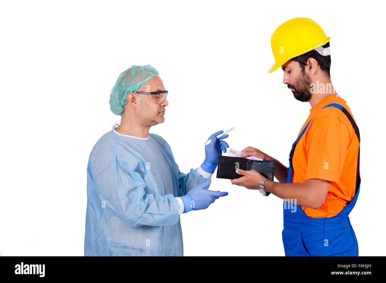 worker paying surgery fee to surgeon isolated on the white background Stock Photo