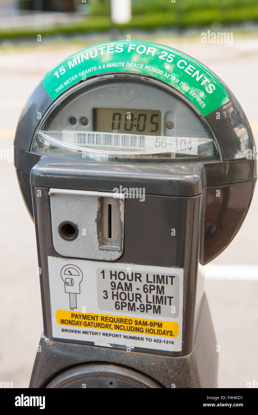 A coin or cash key operated parking meter in White Plains, New York. - Stock Image