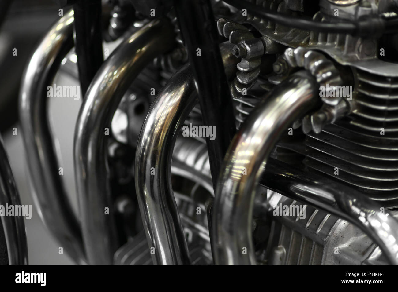 Detail of a motorcycle exhaust pipes and cylinders.. Stock Photo