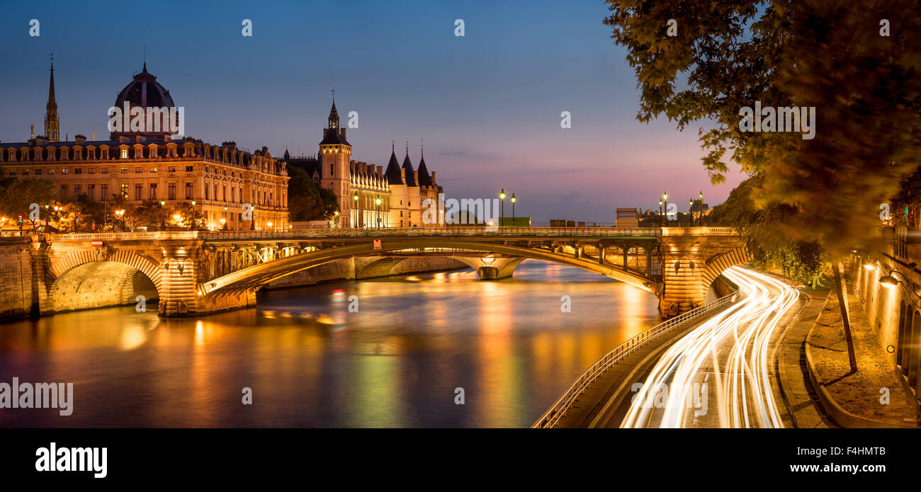Seine River at Dusk with Pont Notre Dame and the Conciergerie on Ile de la Cite, Paris, France. - Stock Image