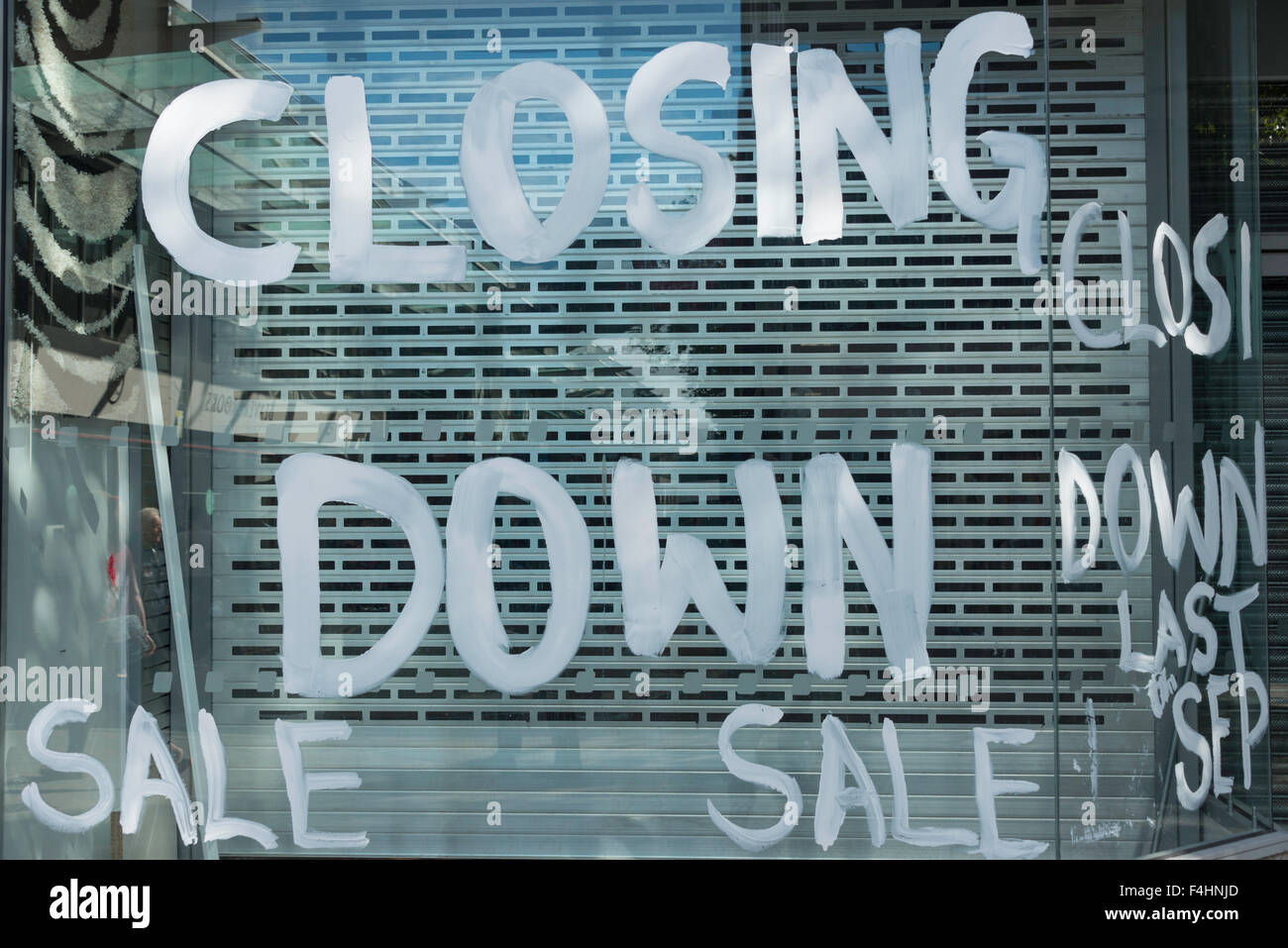 Closing down sign on shop window, Canal Walk, Swindon, Wiltshire, England, United Kingdom - Stock Image