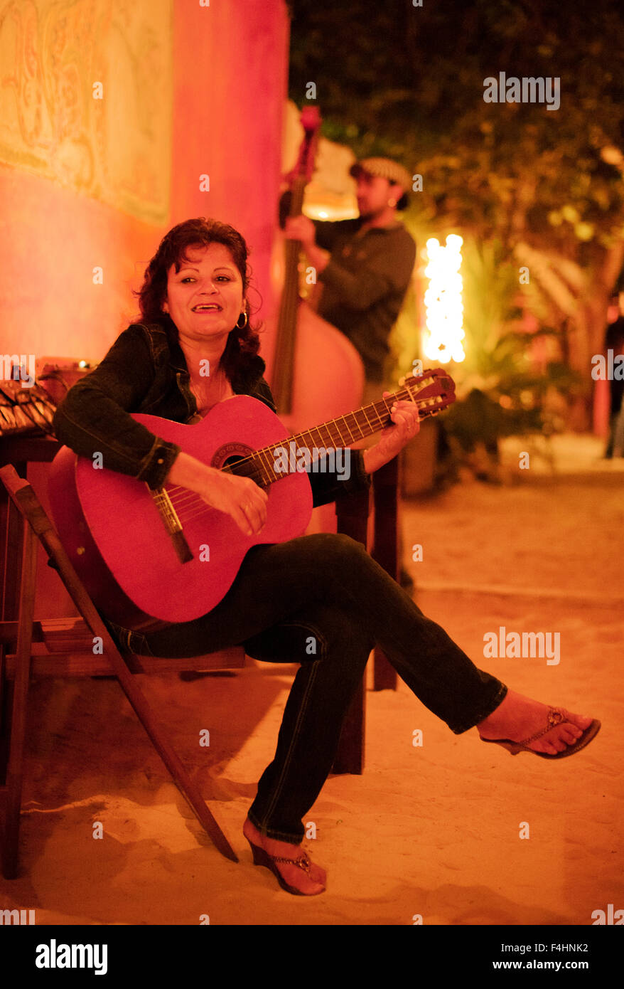 Gladys del Monte and man on bass perform. Isla Mujeres,Mexico. - Stock Image