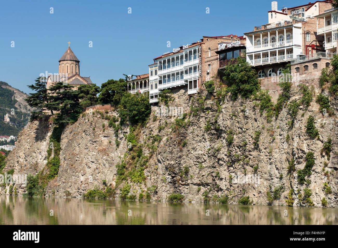 The Metekhi church and buildings lining the Kura River in Tbilisi, the capital of Georgia. Stock Photo