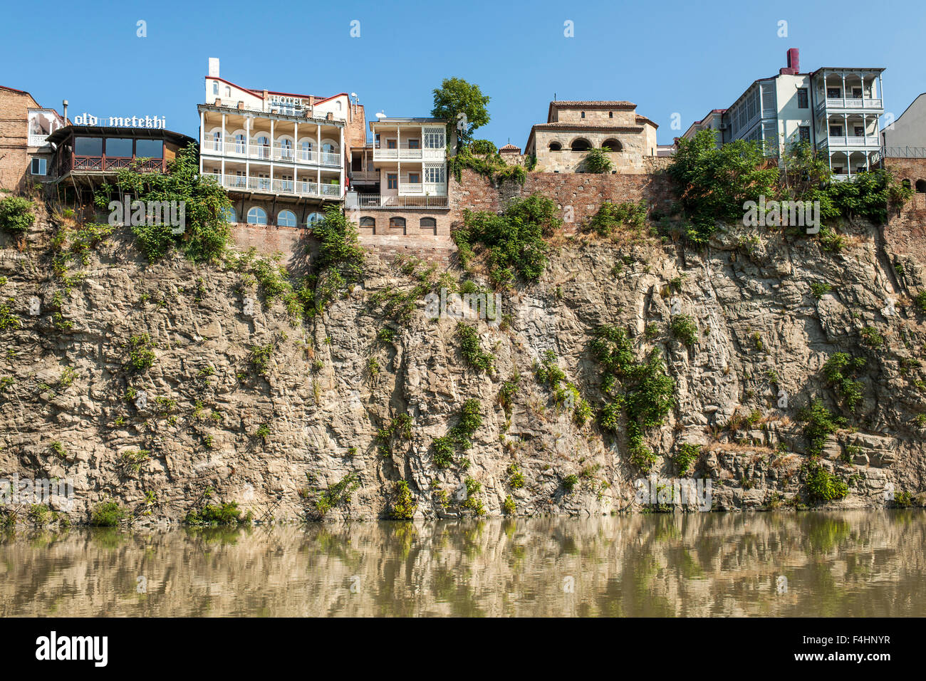 Buildings lining the Kura River in Tbilisi, the capital of Georgia. - Stock Image