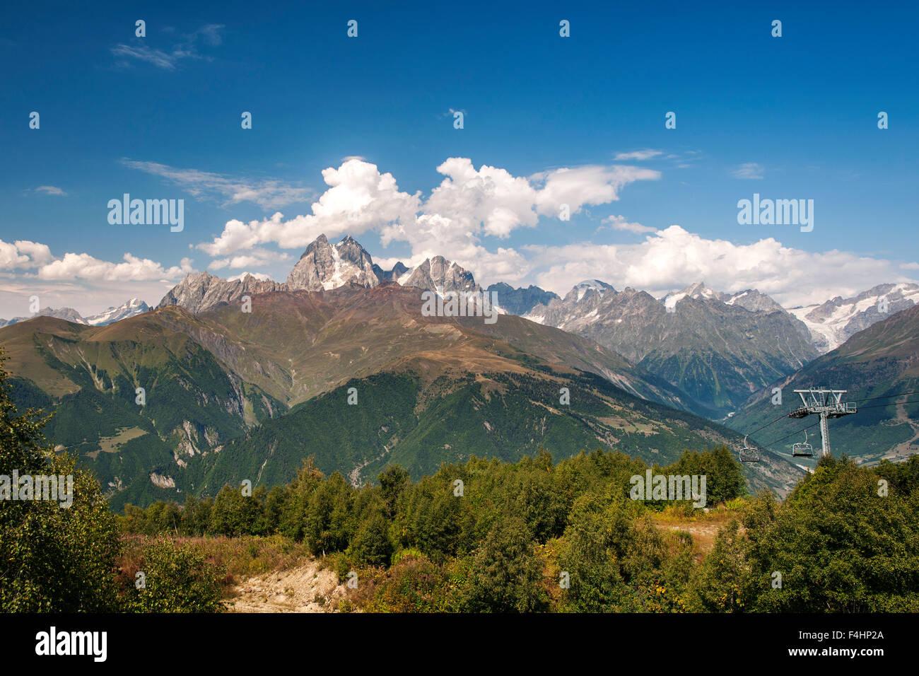 The twin peaks of Mount Ushba (4710m) and the ski lift of Hatsvali ski station in the Svaneti region of northwestern - Stock Image