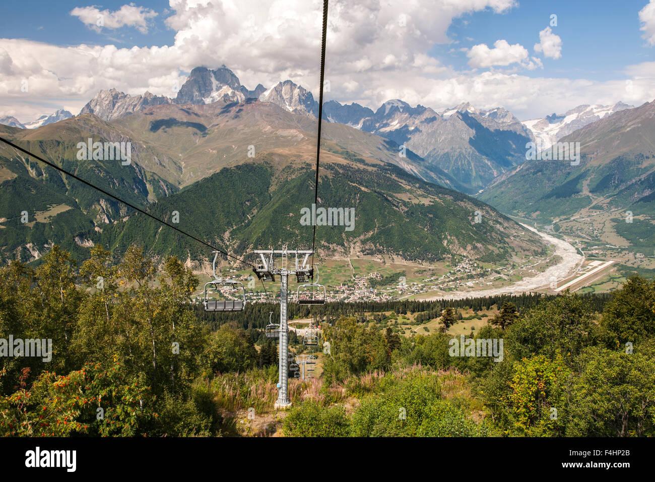 Mestia village and Mount Ushba (4710m) seen from the Hatsvali ski lift in the Svaneti region of northwestern Georgia. - Stock Image