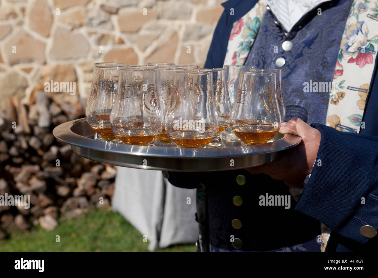 Server holding glasses of whisky - USA - Stock Image