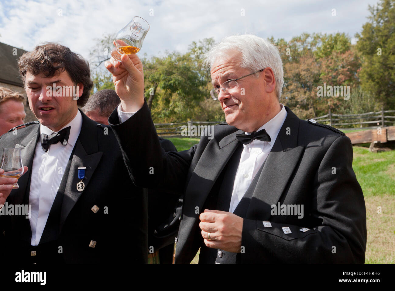 Andy Cant and Dr. William Lumsden tasting George Washington's Distillery Single Malt Whisky - Alexandria, Virginia - Stock Image