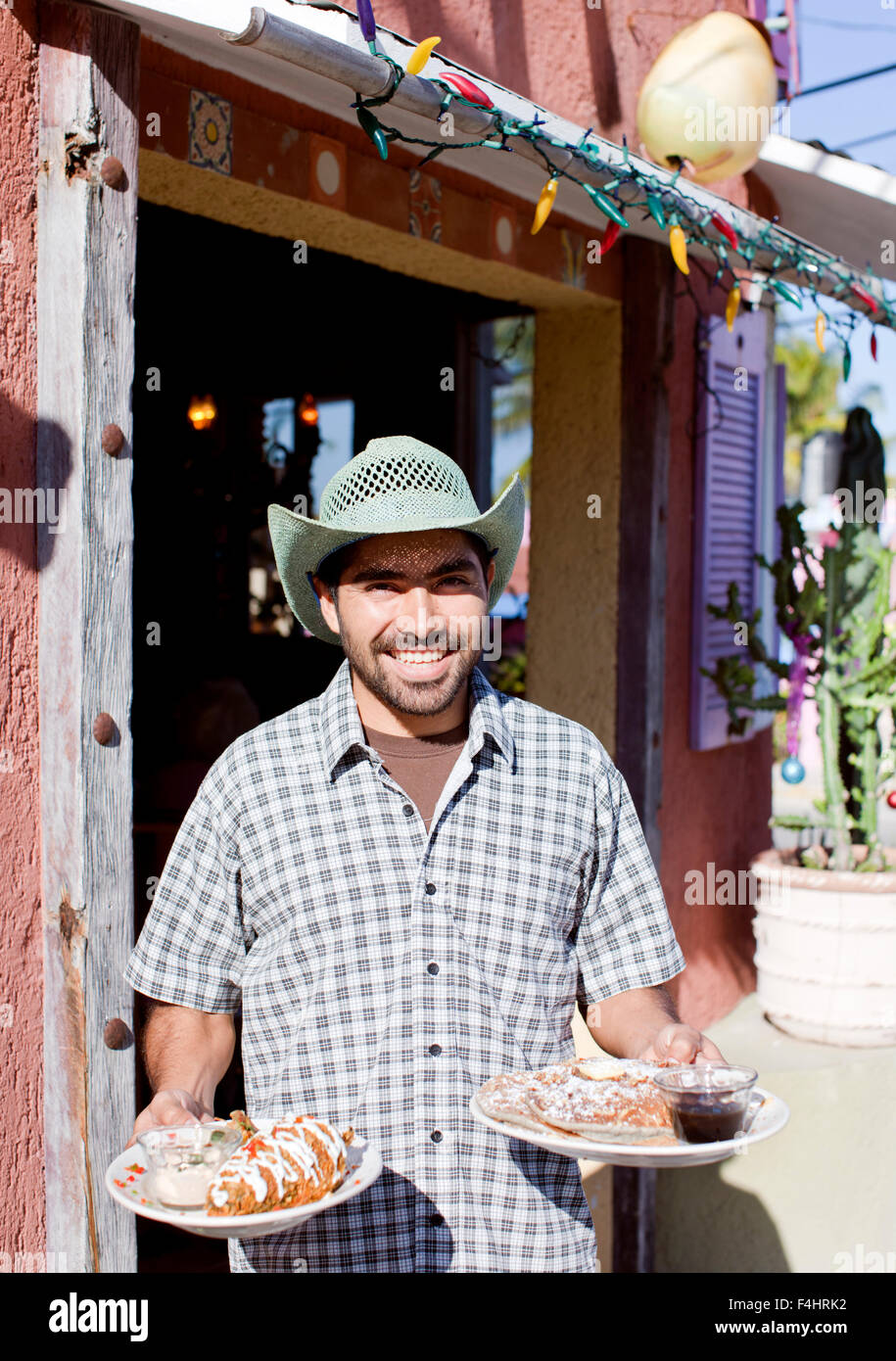 Mango Cafe co-owner Polo Avila stands outside his restaurant. Isla Mujeres, Quintana Roo, Mexico. - Stock Image