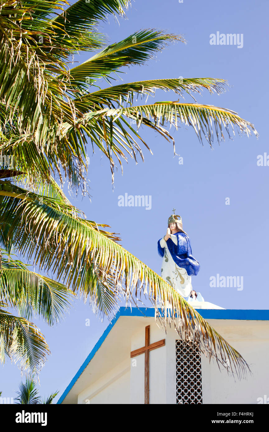 Statue of the Virgin Mary on the roof of the Church of the Immaculate Conception, Isla Mujeres,Mexico - Stock Image