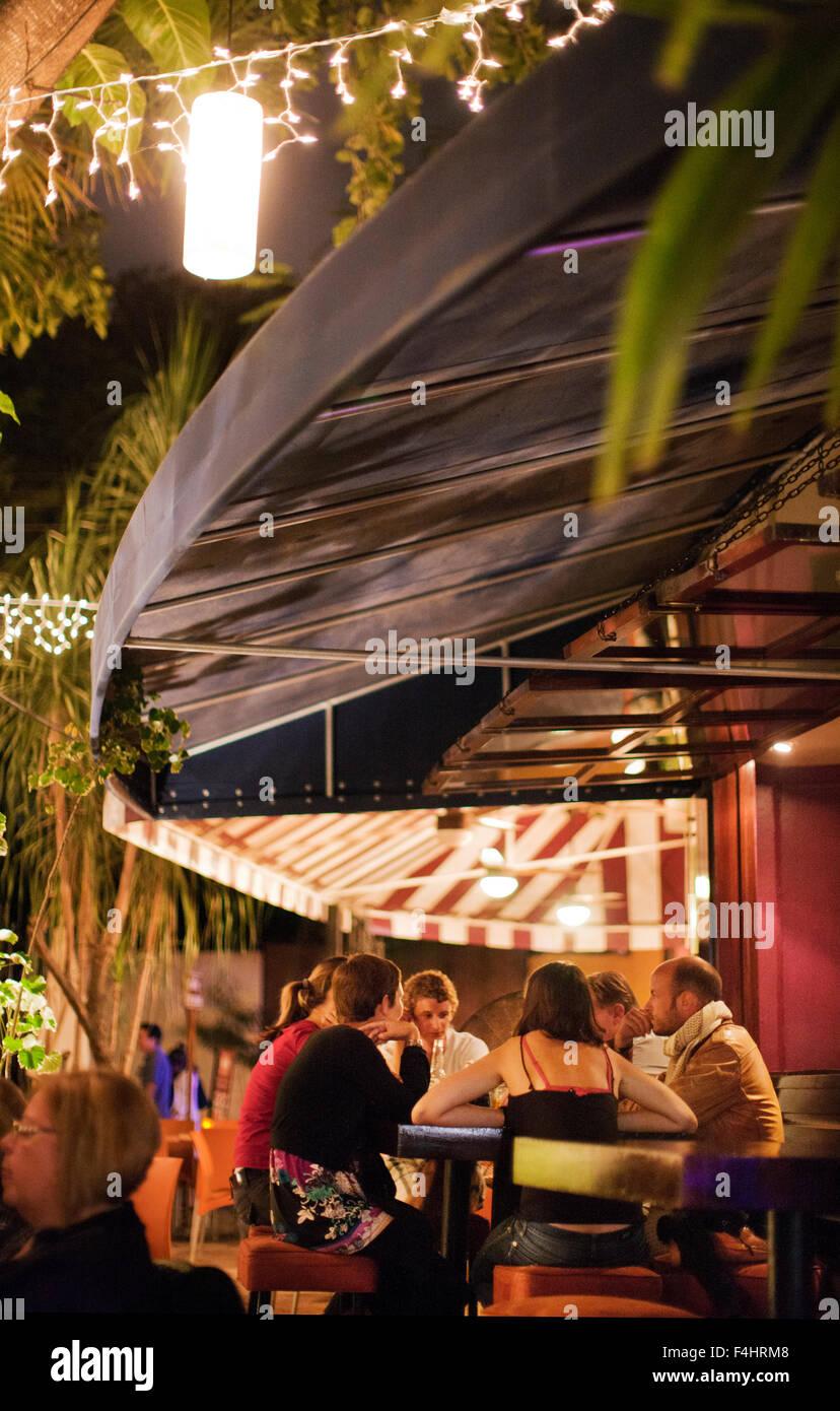 Tourists at happy hour. John Gray's Place  Playa del Carmen, Quintana Roo, Mexico. - Stock Image