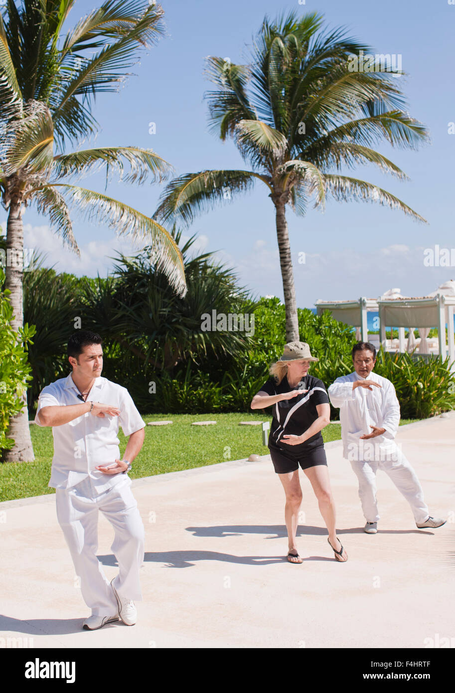 Tai chi class at a resort in Cancun, Mexico. - Stock Image