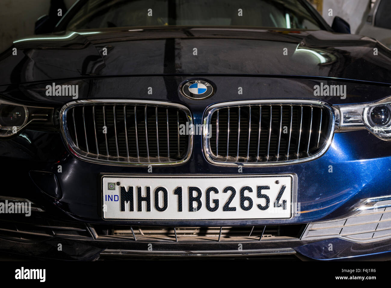 The Front Of A German Bmw Car With A Maharasthra Number Plate A