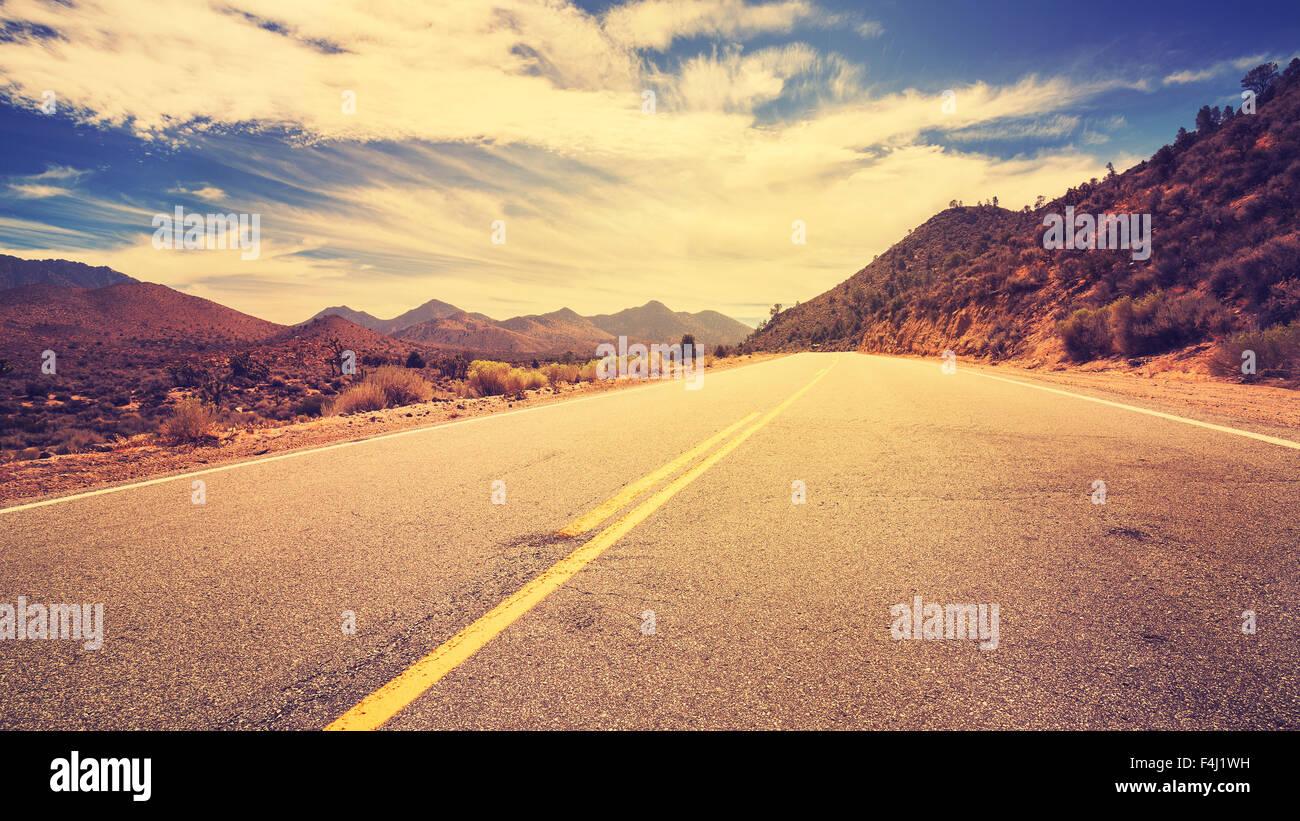 Vintage retro stylized desert road, USA. - Stock Image