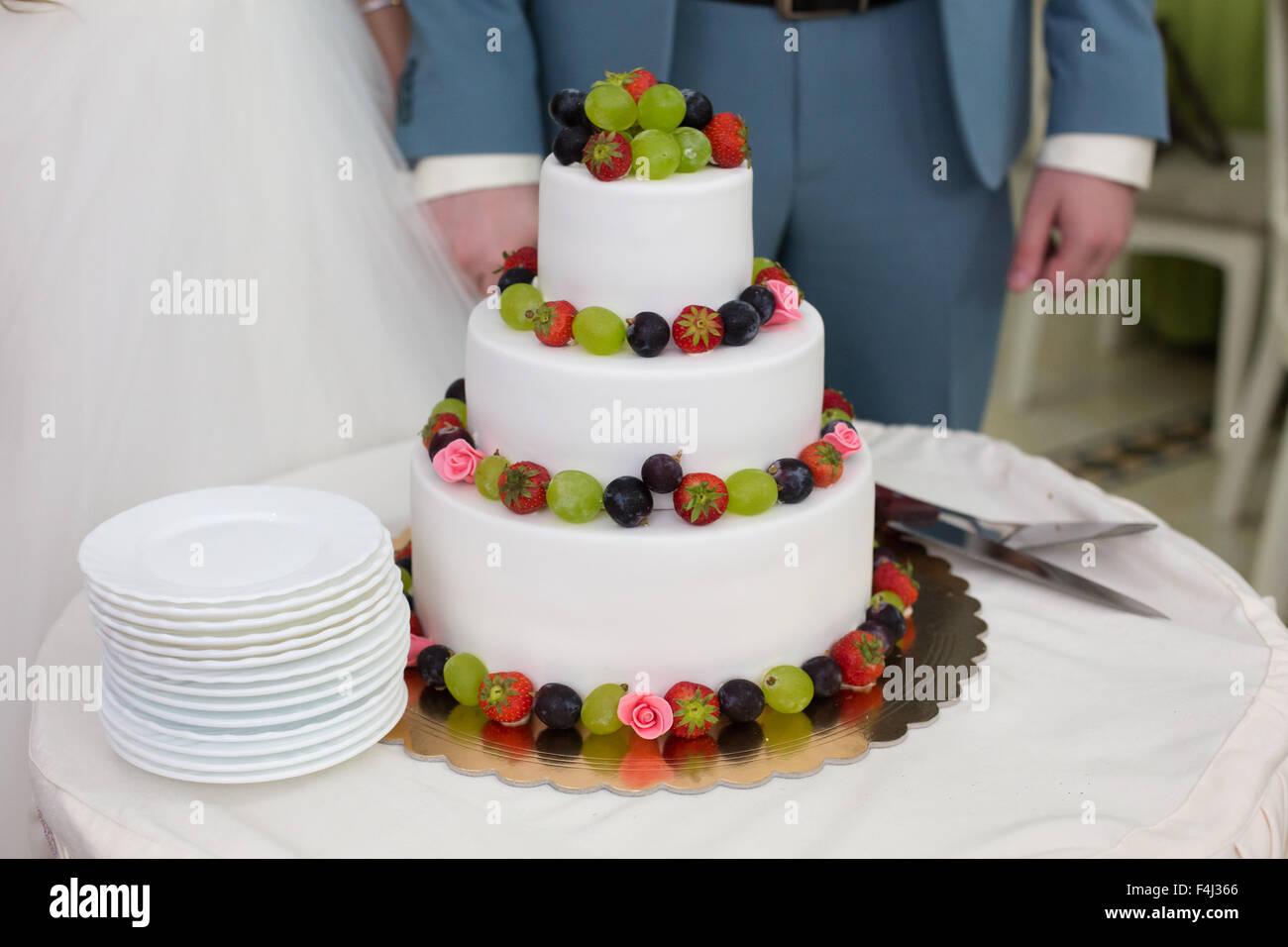 The Couple Cut Wedding Cake