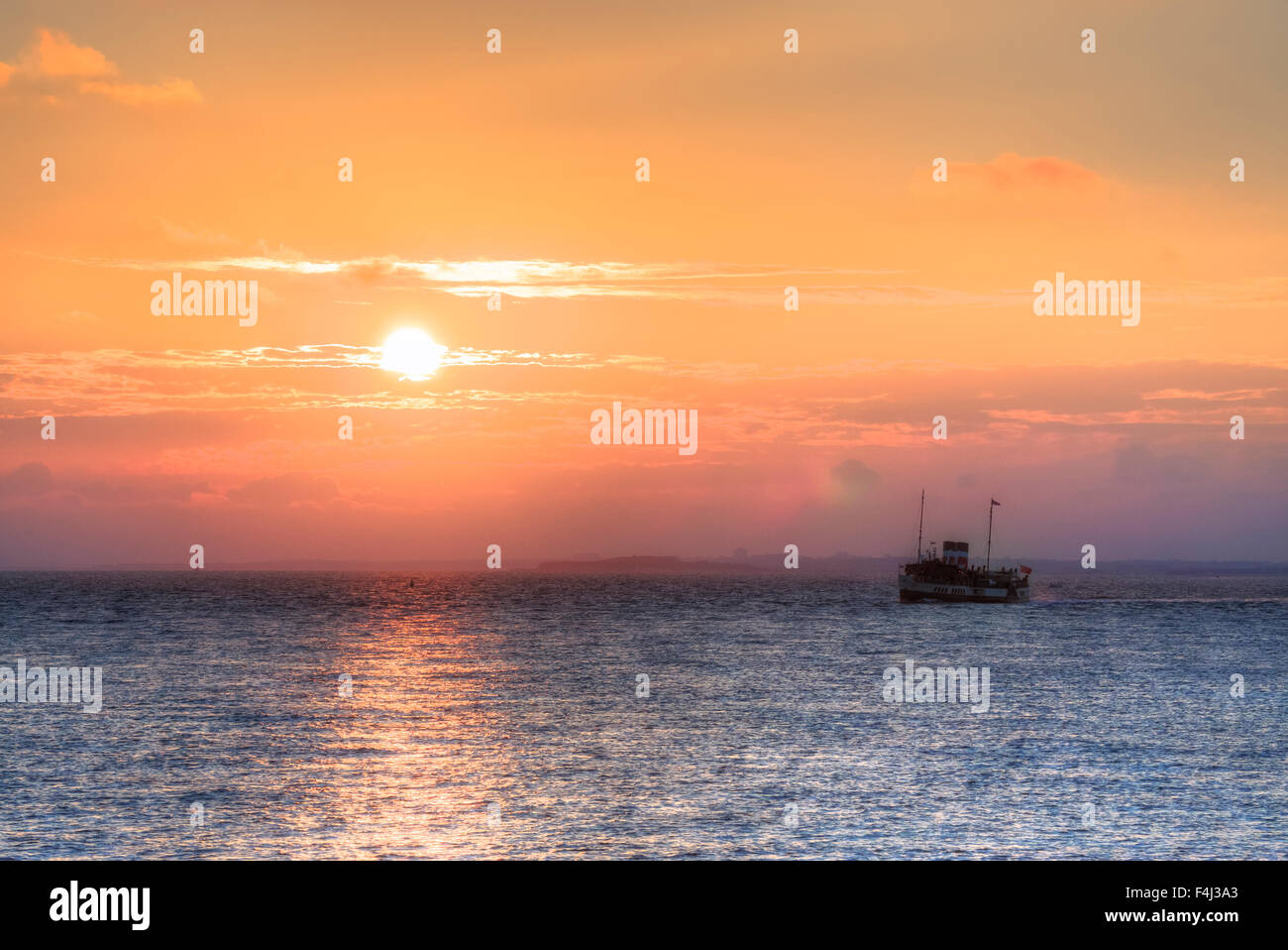 sunset over the Solent in Milford on Sea, Hampshire, England, United Kingdom - Stock Image