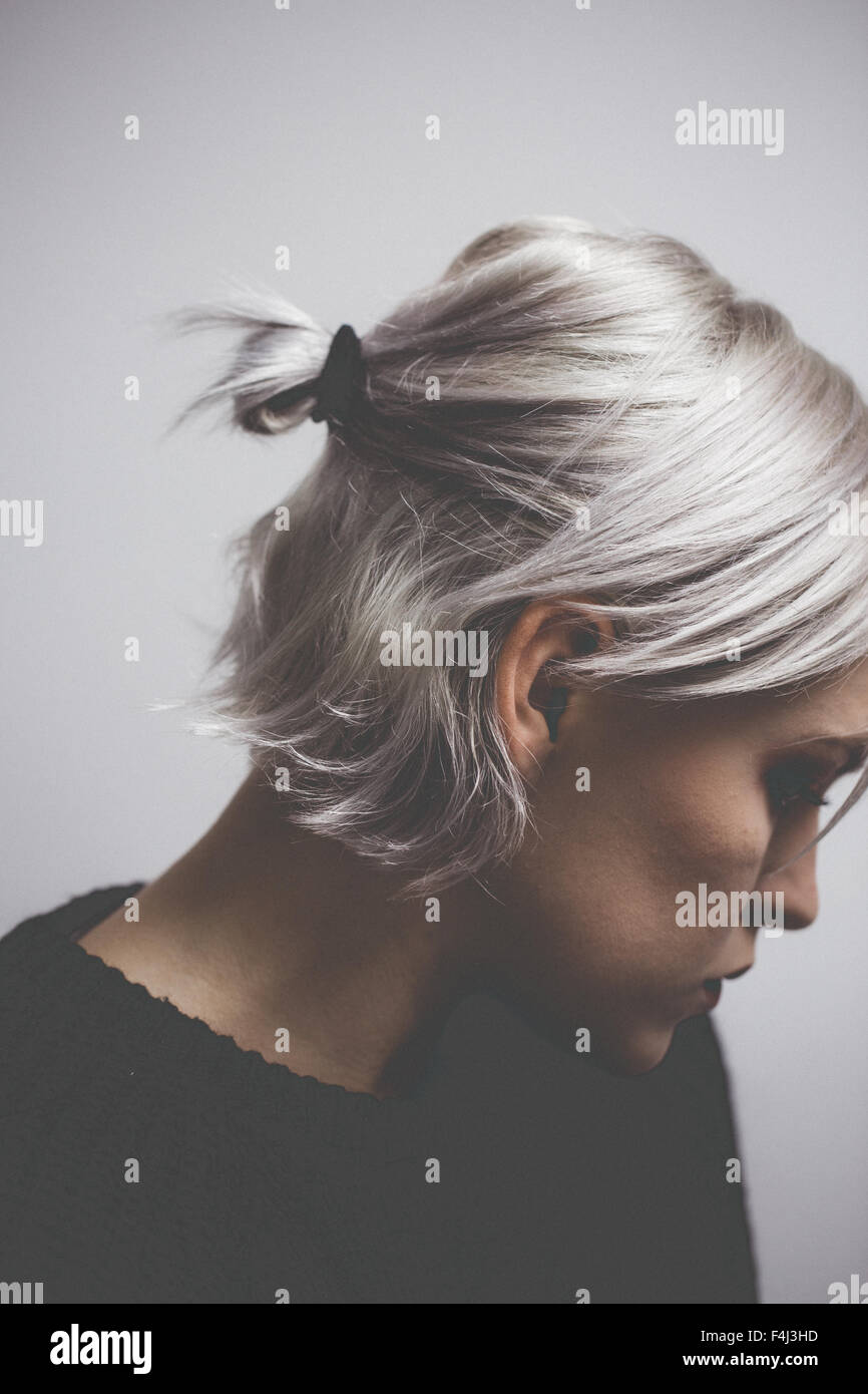 Contemporary hipster girl with silver gray hair - Stock Image