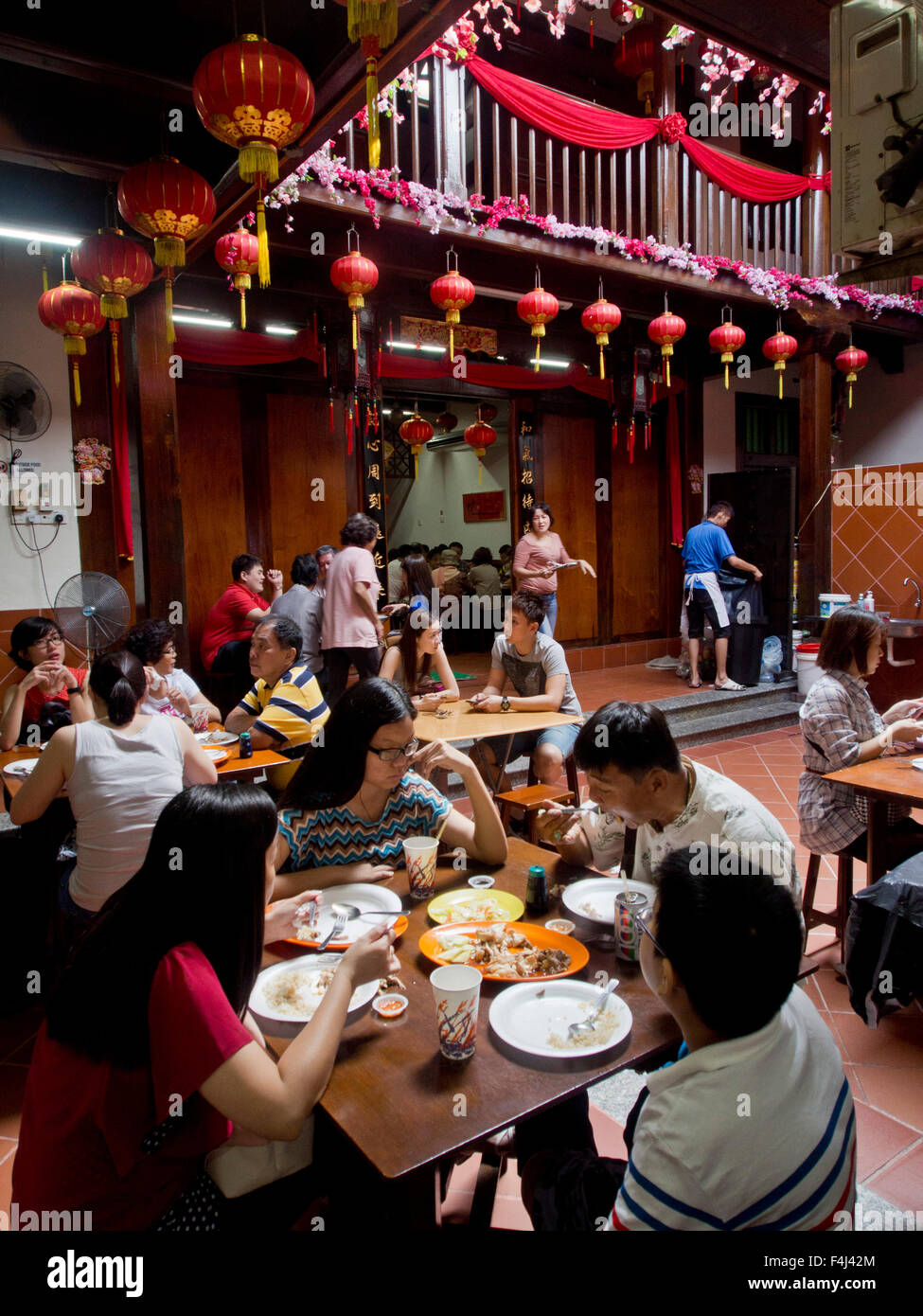 Tourists eat at traditional chinese shophouse restaurant in Malacca, UNESCO World Heritage Site, Malaysia, Southeast - Stock Image