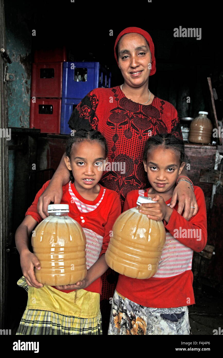 Farmer woman and family with honey produced in a co-operative in the Masha area of Ethiopia, Africa - Stock Image