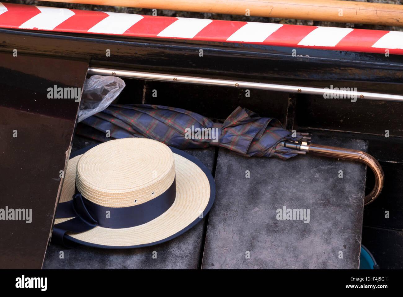 A gondolier s straw hat and umbrella on a gondola f7c0a0dd6