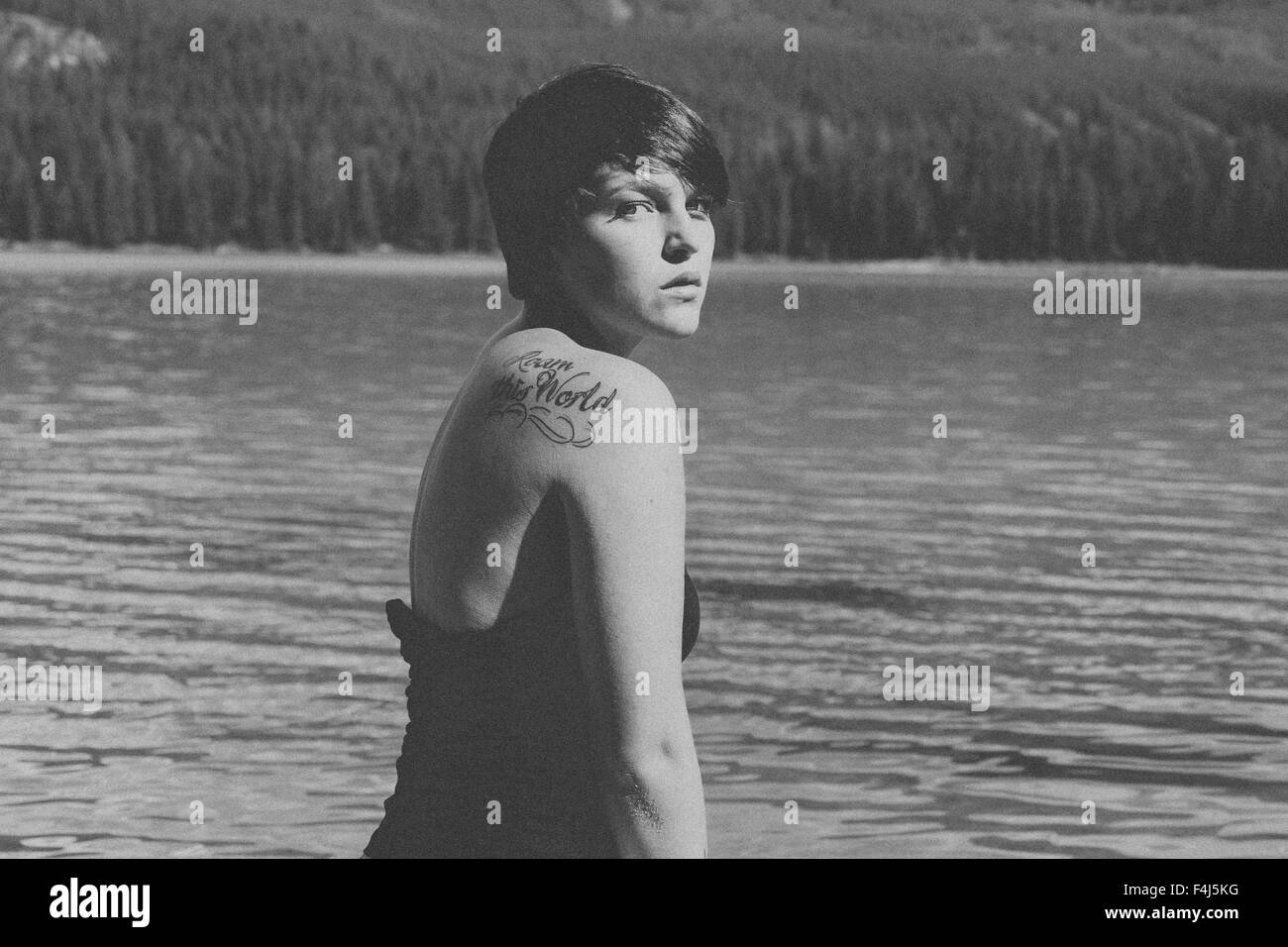 Young beautiful woman traveling in Jasper, Canada in black and white Stock Photo