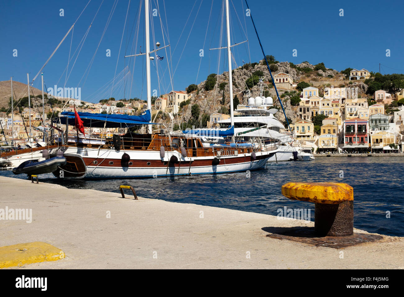 A twin masted gulet  in the harbour at Yialos, on the Greek island of Symi. Stock Photo