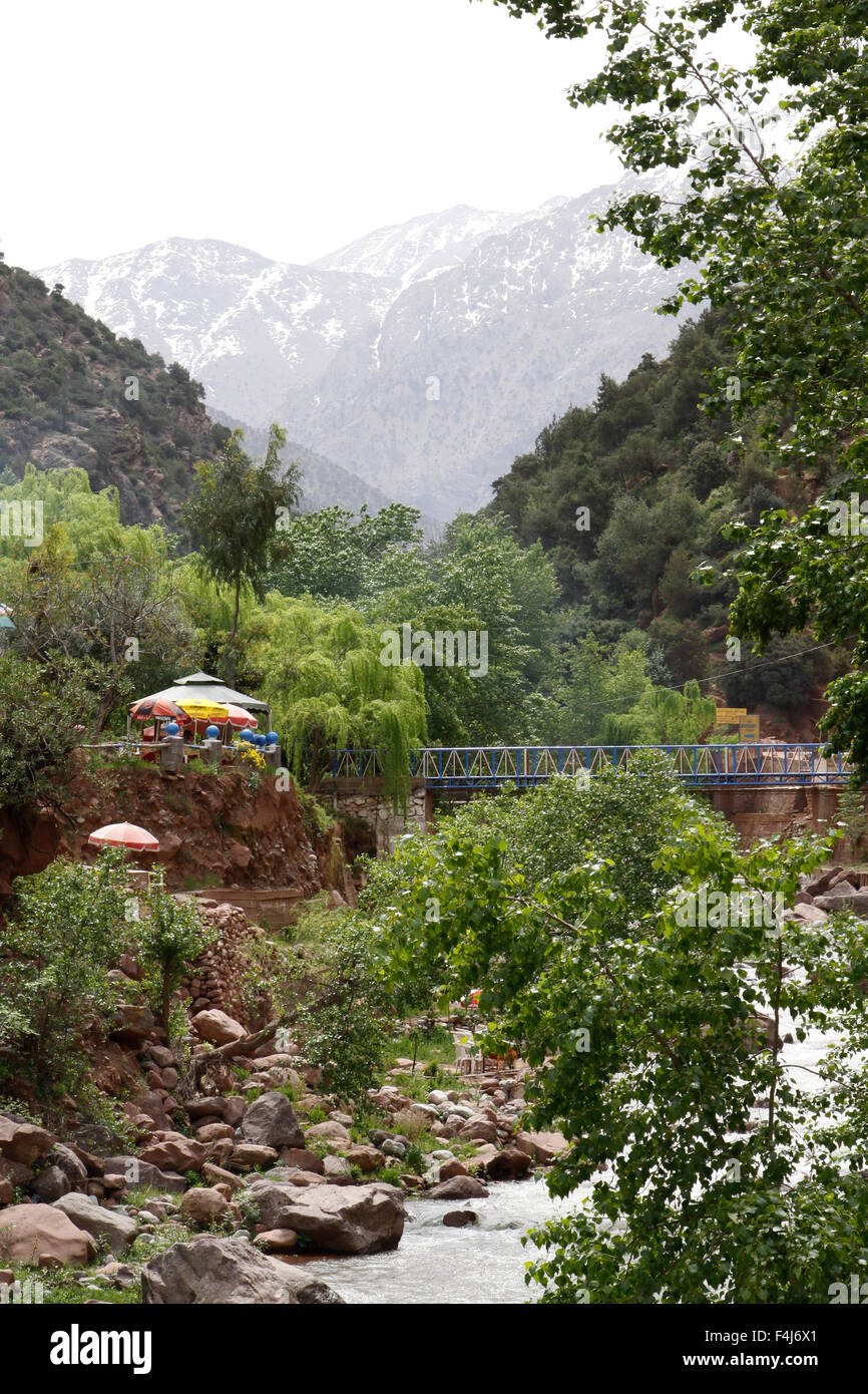 Cafe in the Ourika Valley at Setti Fatma, a popular village south of Marrakesh, Morocco. Snow-capped Atlas Mountains in distance Stock Photo