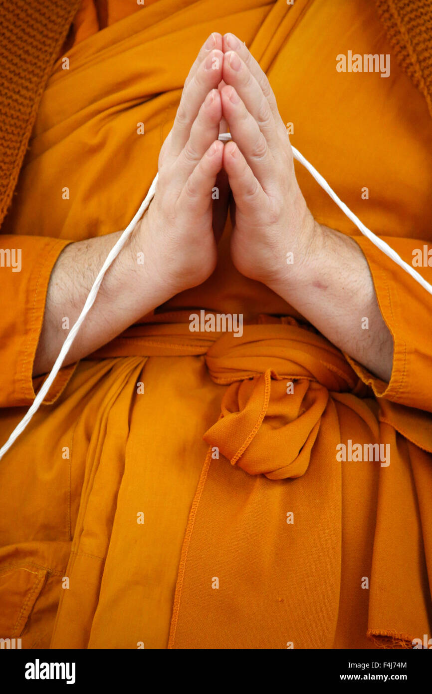 Monk praying, Wat Velouvanaram, Bussy Saint Georges, Seine et Marne, France, Europe - Stock Image