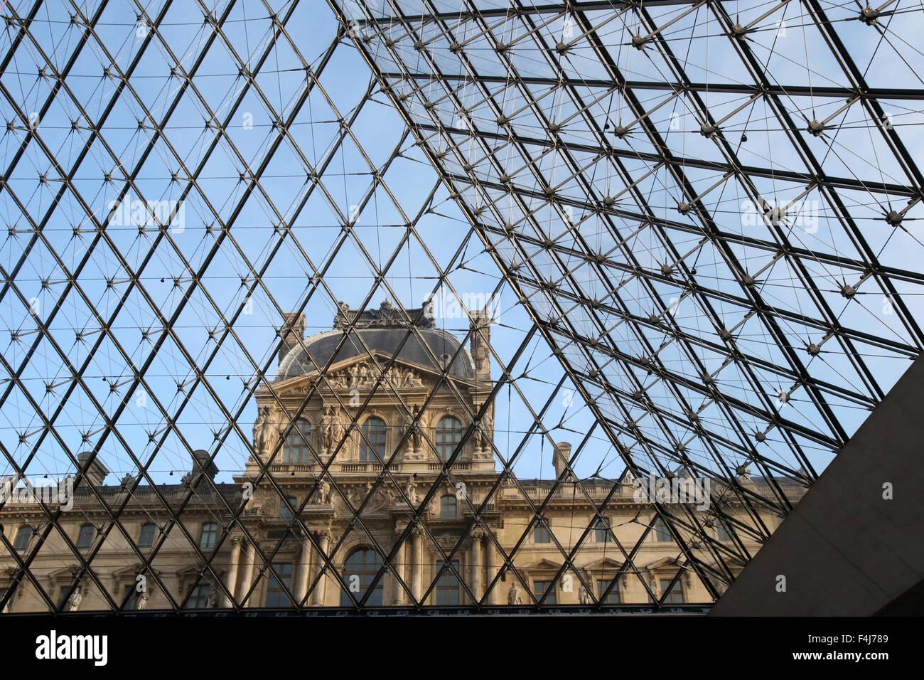 Palais du Louvre seen through the Pyramid, Paris, France, Europe - Stock Image