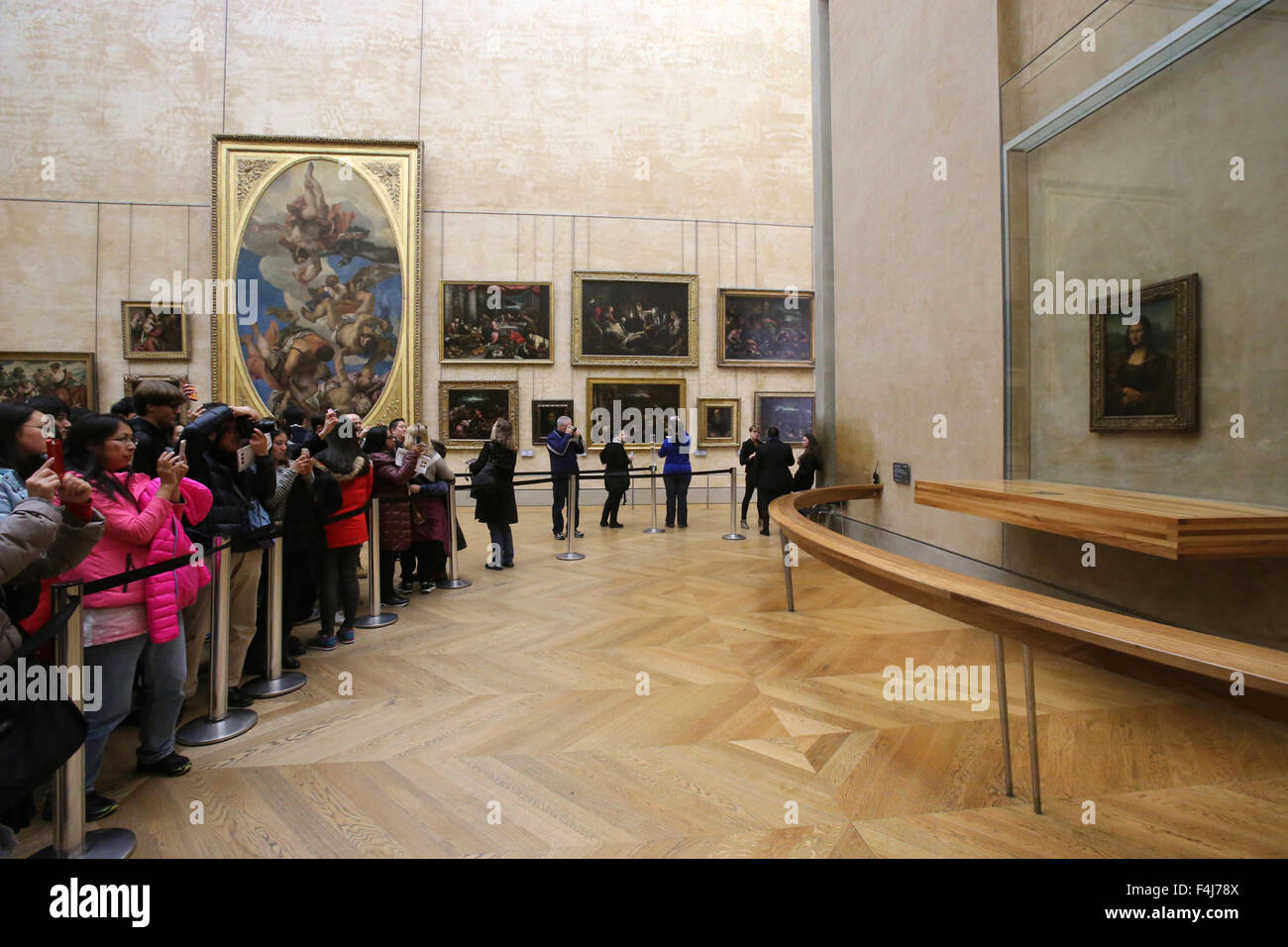 A crowd of tourists photographing the Mona Lisa portrait at the Louvre Museum, Paris, France, Euruope - Stock Image