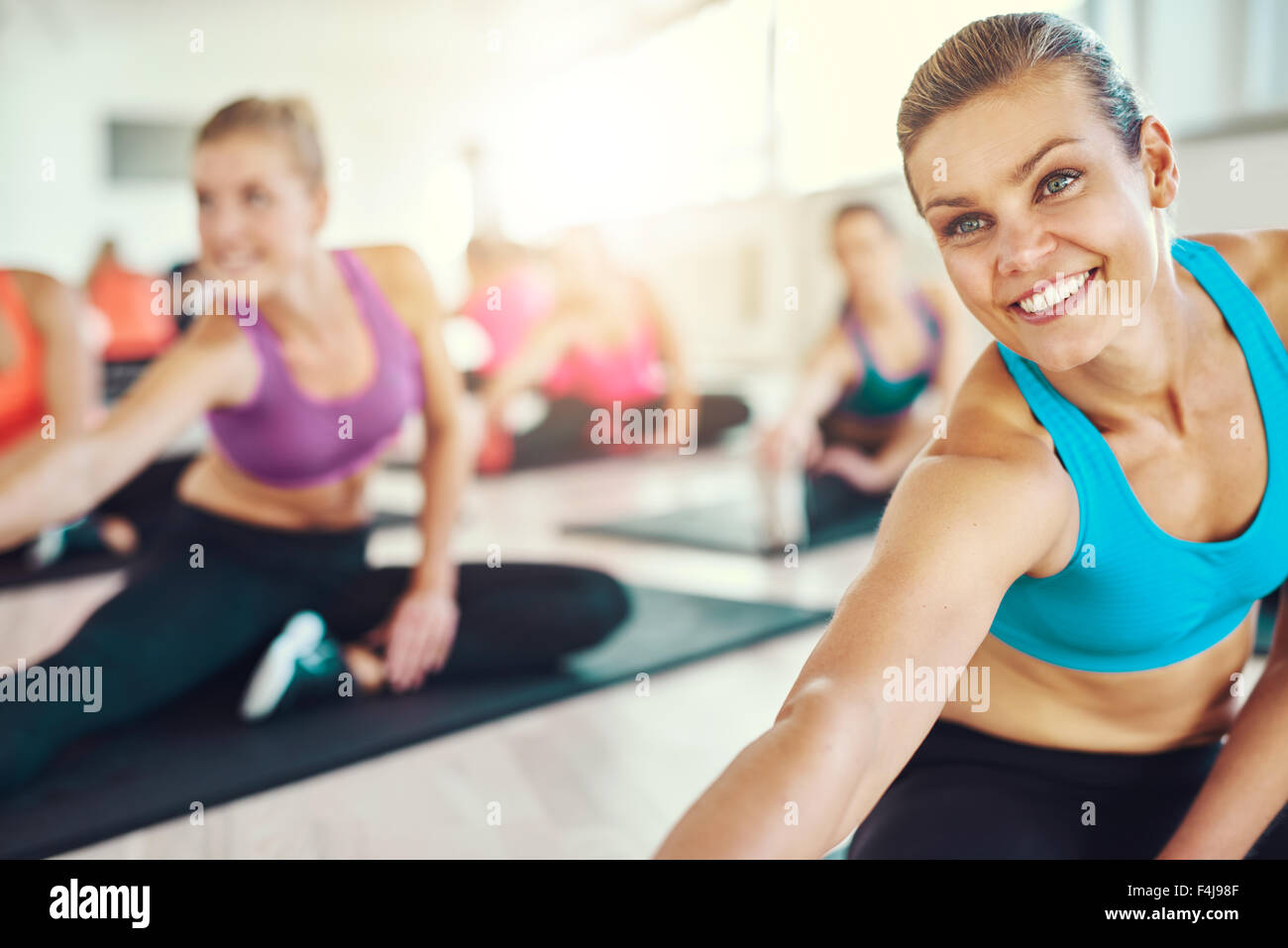 Fit and healthy woman in a fitness class, colorful sportswear, fitness, aerobics, sport concept - Stock Image