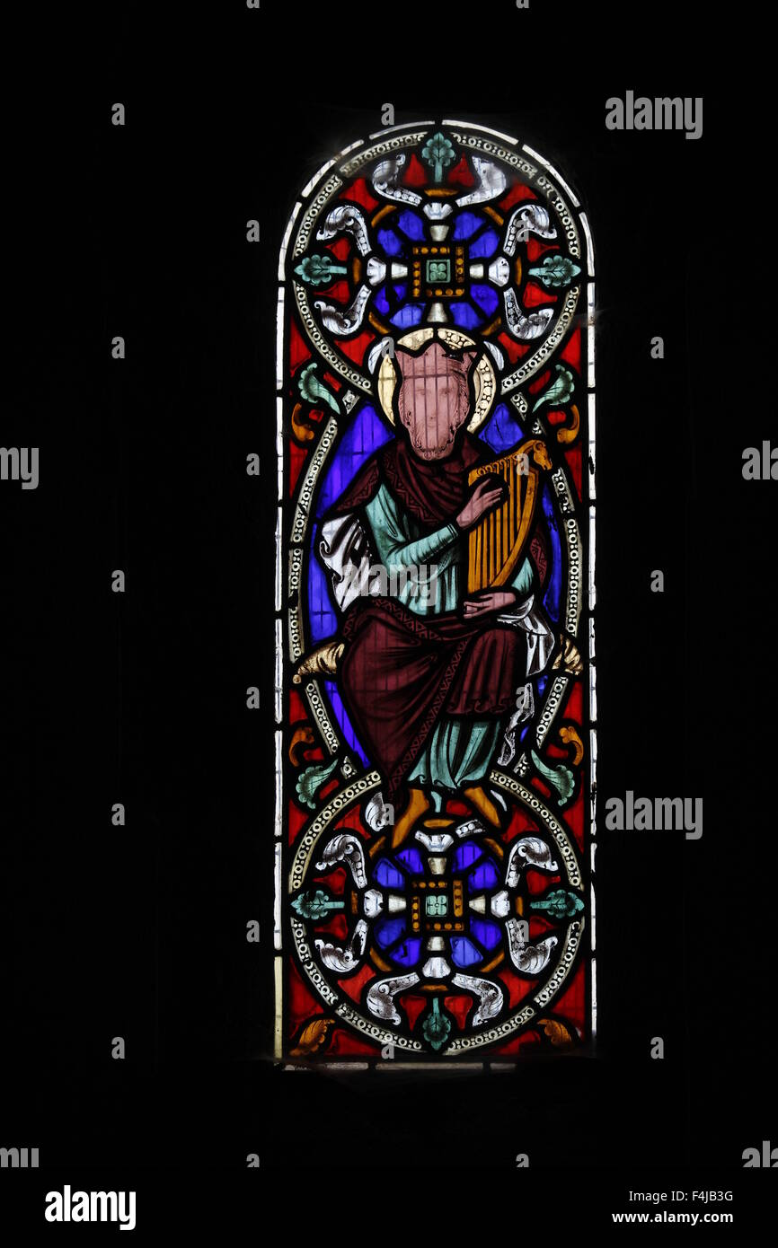 Stained glass window by Augustus Welby Pugin depicting King David holding Goliath's head, Kilpeck Church, Herefordshire, - Stock Image