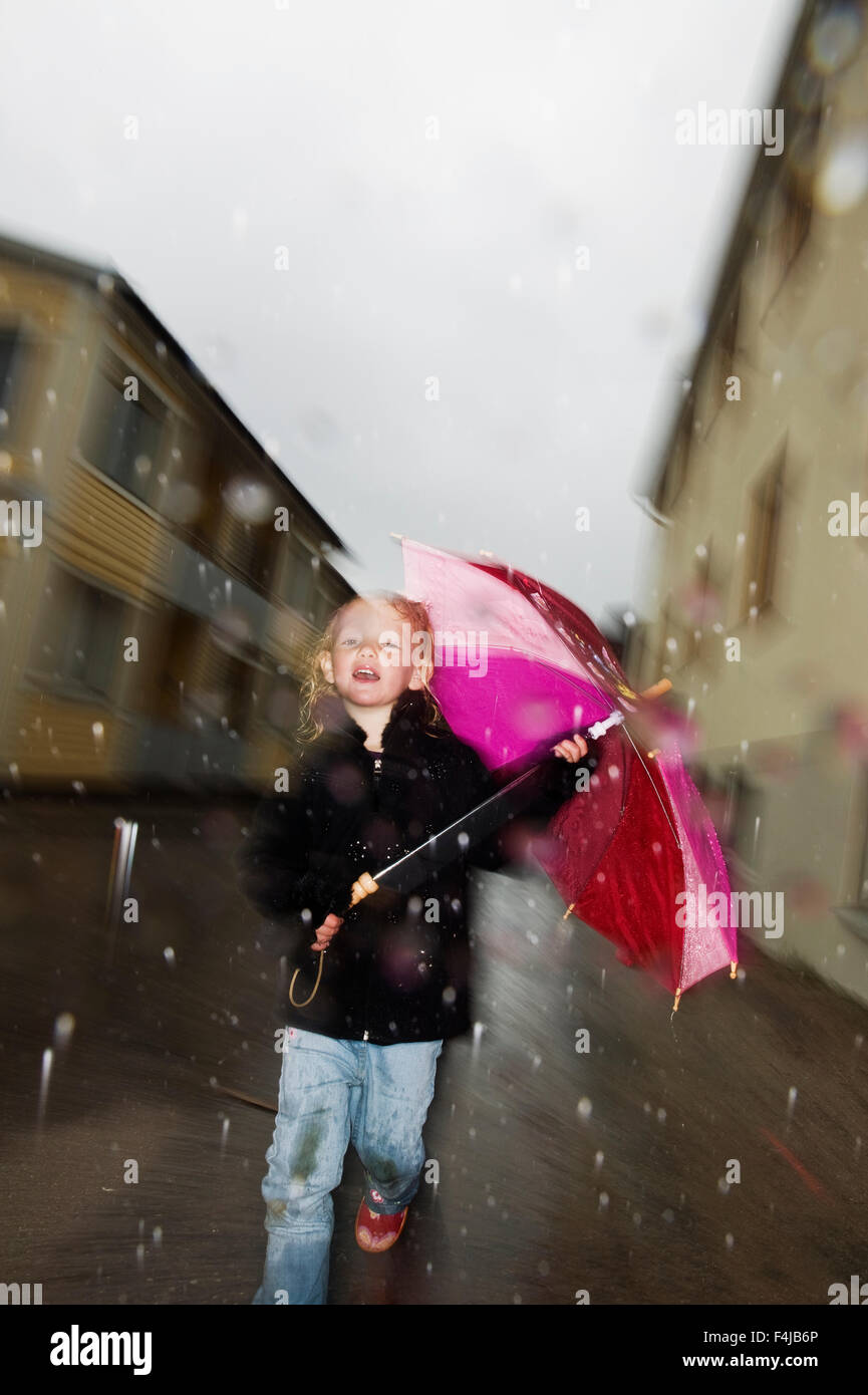 Young girl with a umbrella - Stock Image