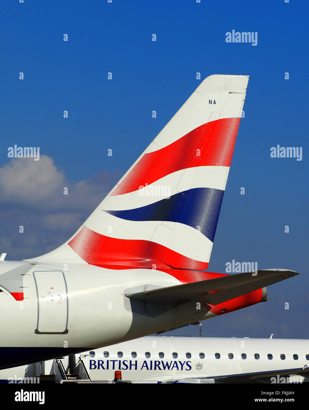 British Airways tail fin plane logo and blue sky Stock Photo