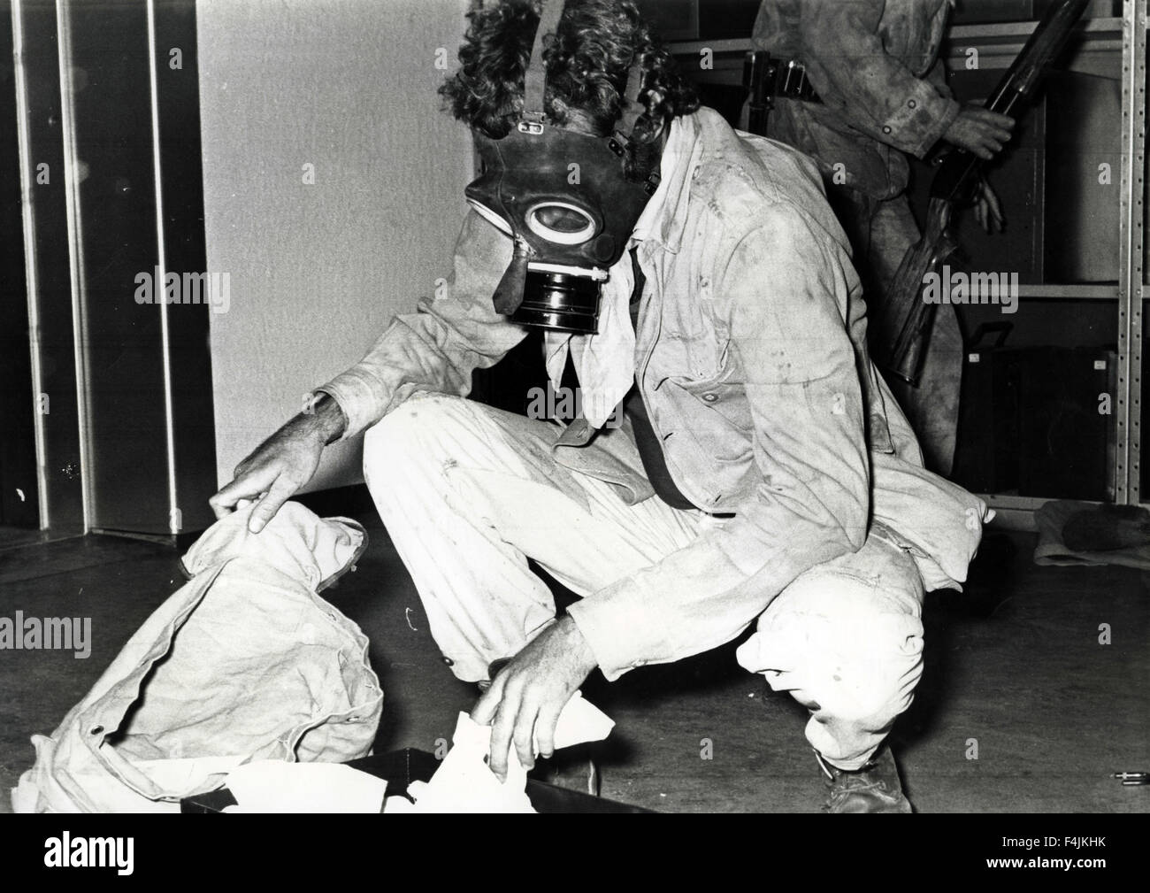 Man with gas mask raids, movie still of unidentified movie - Stock Image