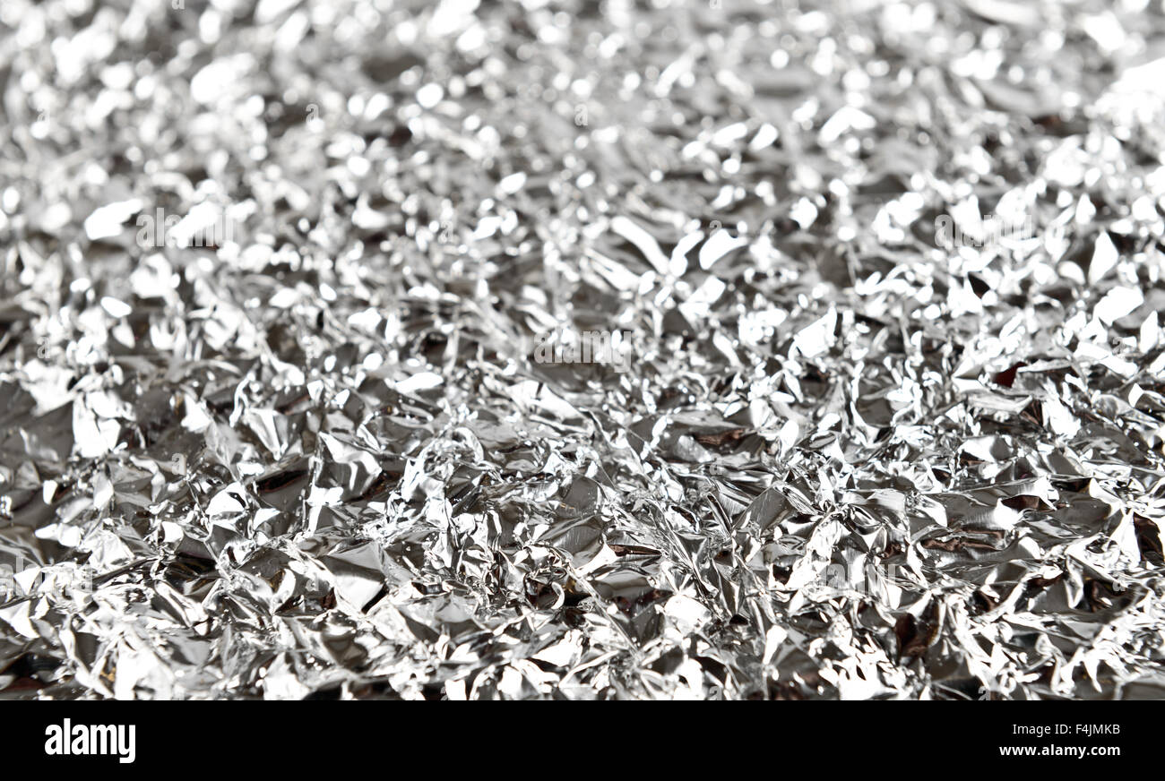 crumpled foil texture or background - Stock Image