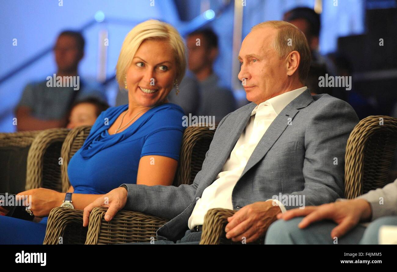Russian President Vladimir Putin sits alongside former world professional boxing super middleweight champion Natalia - Stock Image