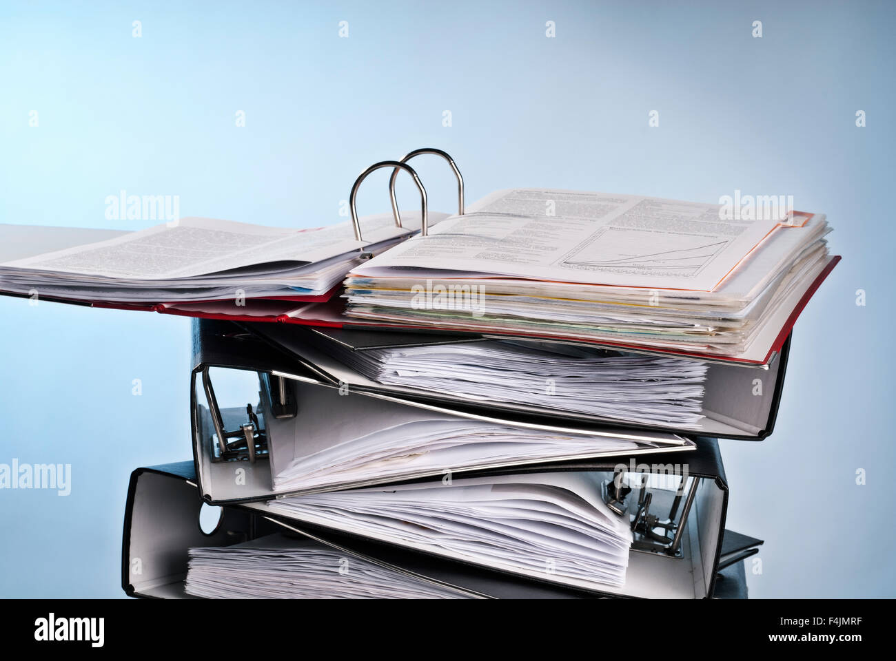 Open folder on a pile of other folders. - Stock Image