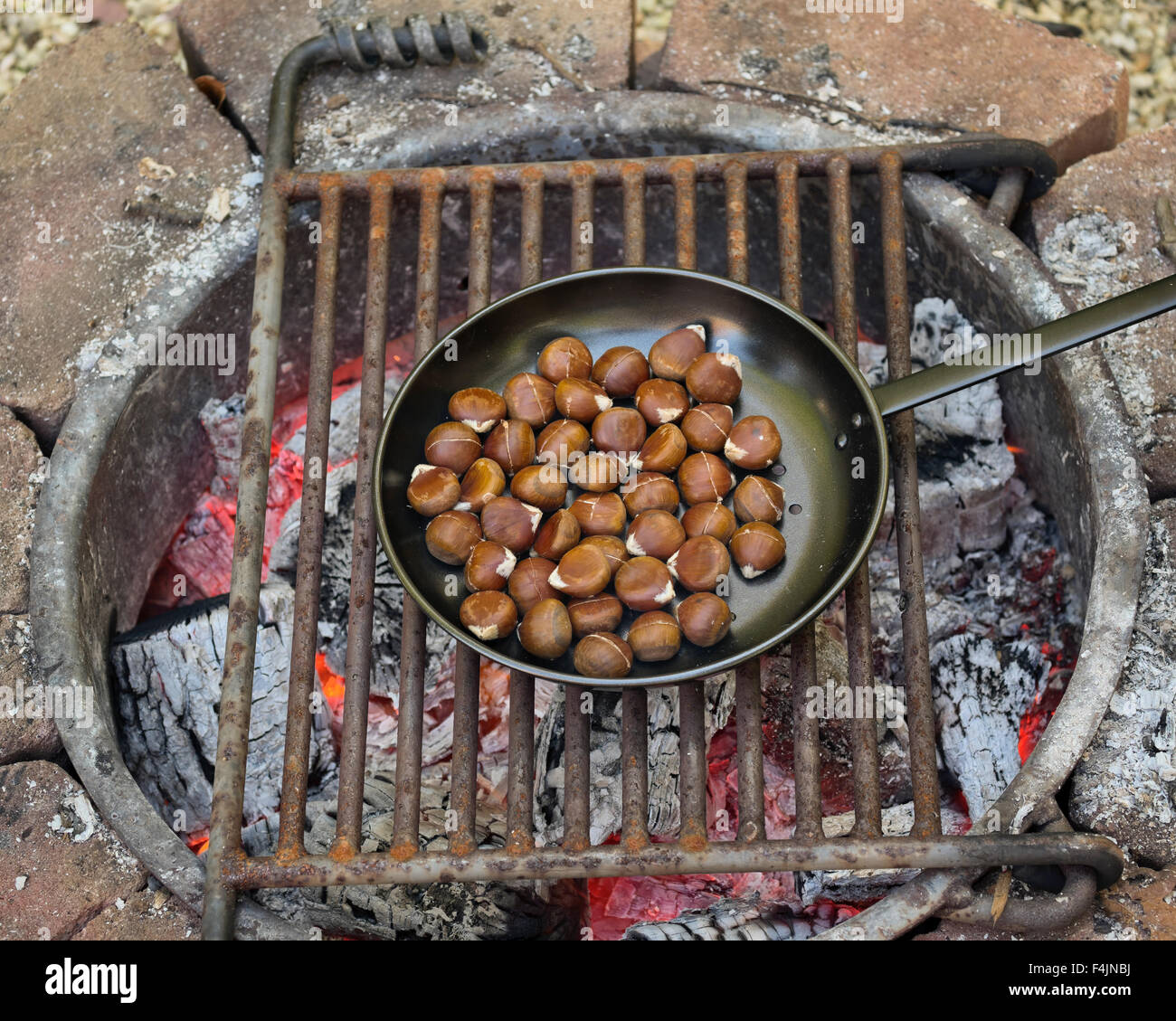 chestnuts roasting on an open fire - Stock Image