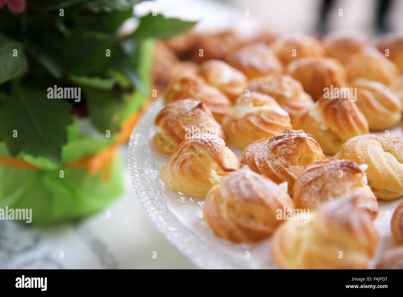 Cream Puffs (Eclairs) on a buffet table - Stock Image
